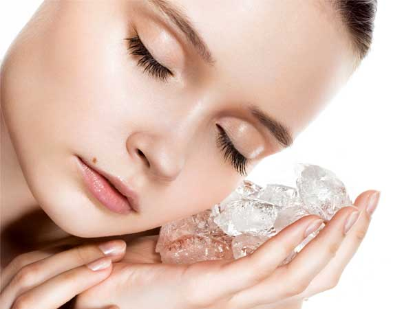 applying ice cubes to reduce pimples