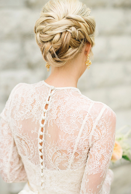 10- ELEGANT BUN WITH OVERLAPPING BRAIDS