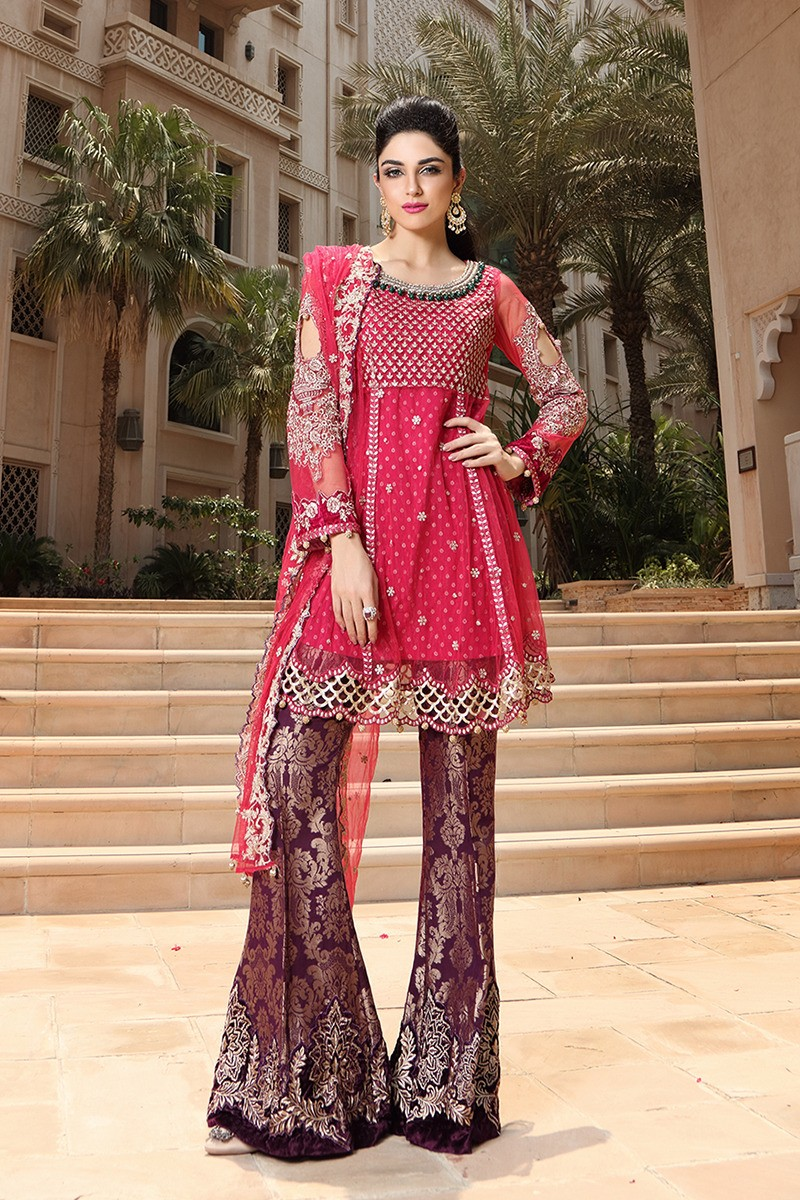 Latest pakistani dresses styles pairing bell bottom pants Pakistani fashion designers