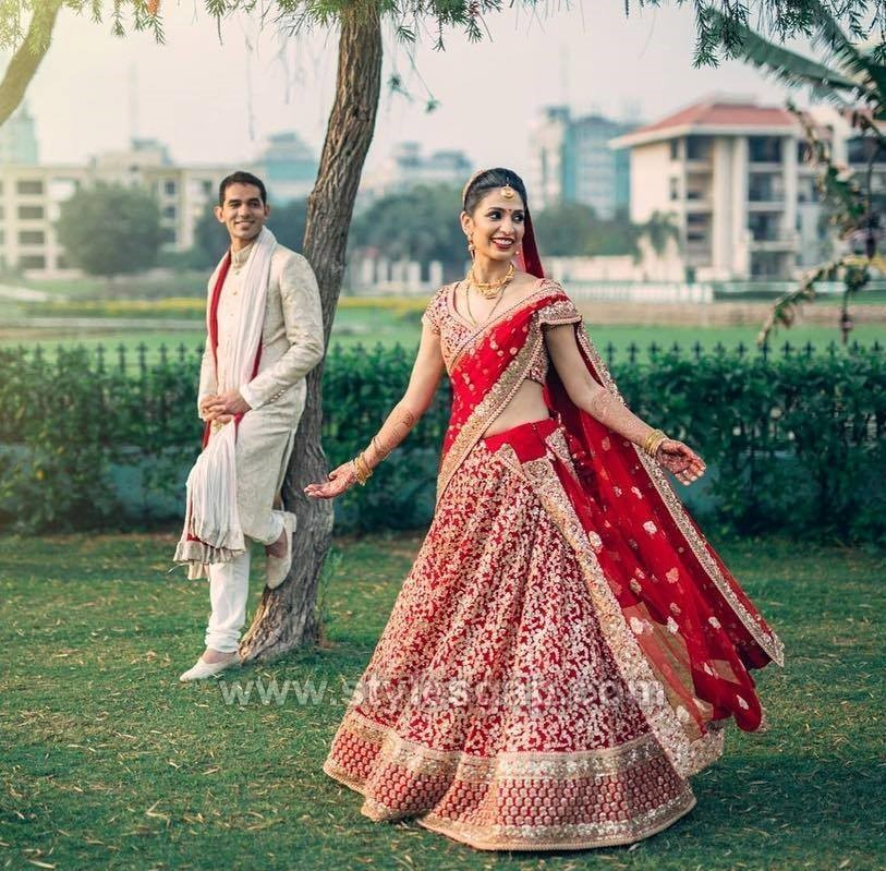 74539969f9 The top is simple and contrasts with the theme. Most designers also pair  lehenga choli with a shimmering chain belt in ivory of silver with heavy  tousles.