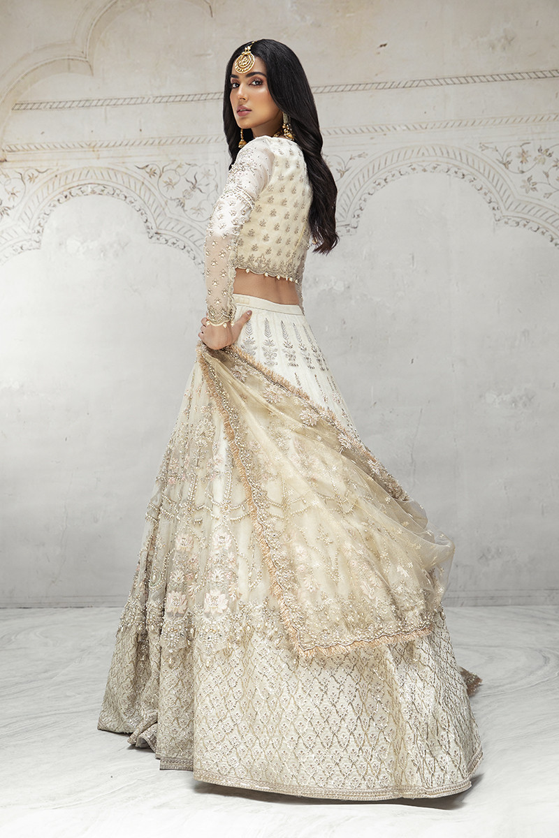 Extravagant Lehnga Choli constructed with meticulous handwork using pearls, diamontes, and sequins.